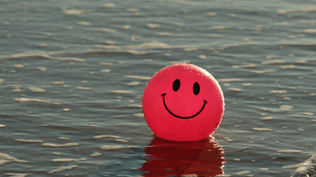 smiley face balloon helping you achieve happiness